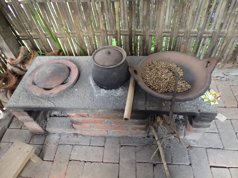 Semi-traditional stove and cooking utensils for roasting the coffee beans while making kopi luwak.